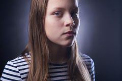 Portrait of a little girl with evil face Stock Photo