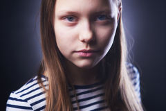 Portrait of a little girl with evil face Stock Image