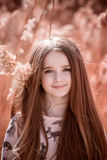 Portrait of little girl. In field in the summer Stock Photos