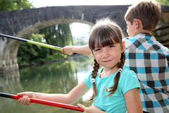 Portrait of little girl fishing in river Royalty Free Stock Image