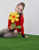 Portrait of a  little girl  with flower sitting on the floor Stock Images