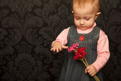 Portrait of a little girl with flowers stock photo