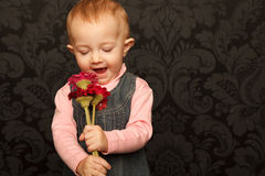 Portrait of little girl with flowers in her hands Royalty Free Stock Photography