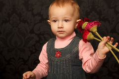 Portrait of little girl with flowers in her hands stock images