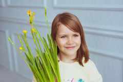 Portrait of a little girl with a flowers. Portrait of a pretty little girl with a flowers Royalty Free Stock Photo