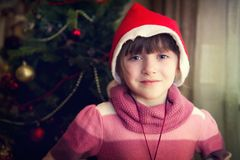 Portrait of little girl in front of Christmas tree Stock Photography