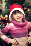 Portrait of little girl in front of Christmas tree Royalty Free Stock Photos