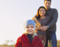 Portrait of the little girl with a funny hat outdoors and man an Royalty Free Stock Photography