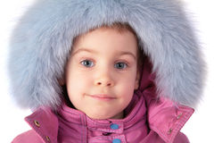 Portrait of little girl in furry hat Royalty Free Stock Images