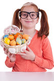 Portrait of little girl with glasses holding Easter egg basket Royalty Free Stock Photography