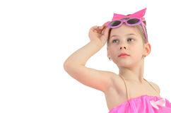 Portrait of a little girl with glasses looking up imagining Stock Image