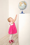 Portrait of little girl with globe Stock Photography