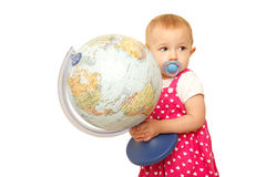 Portrait of little girl with globe in hands, on it Stock Image