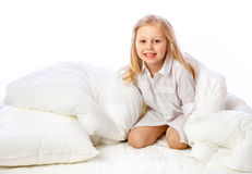 Portrait of a little girl goes to bed, bed, sleep, rest Stock Images