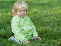 Portrait of a little girl in the green grass Stock Photo