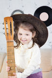 Portrait of the little girl with a guitar in hands Stock Images