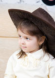 Portrait of the little girl with a guitar in hands Royalty Free Stock Photo