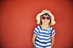 Portrait of little girl in hat and sunglasses Stock Image