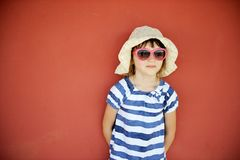 Portrait of little girl in hat and sunglasses Stock Photography