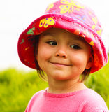 Portrait of a little girl in a hat. For a walk, photo took in New Zealand, photo is usable on picture post card Stock Photos