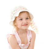 Portrait of little girl in hat on white background. Portrait of little girl in hat sitting on white background Stock Photo