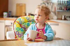 Portrait of little girl having drink Stock Image