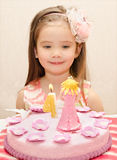 Portrait of little girl and her birthday cake Royalty Free Stock Image