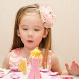 Portrait of  little girl and her birthday cake Royalty Free Stock Images