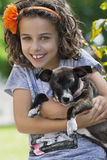 Portrait of little girl with her dog. Portrait of young girl with her puppy dog with smile Stock Images