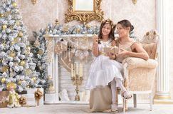 Girl with her mother with Christmas gift. Portrait of little girl with her mother with Christmas gift Stock Photo