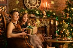 Girl with her mother with  gift. Portrait of little girl with her mother with Christmas gift Stock Image
