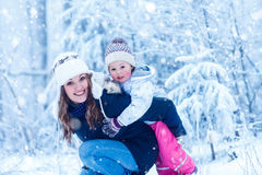 Portrait of a little girl and her mother in winter Stock Image