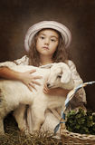 Portrait of a little girl with her pet goat Royalty Free Stock Photography