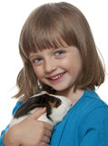 Portrait of little girl and her pet a guinea pig Royalty Free Stock Photography