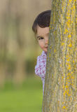Portrait of a little girl hiding Stock Photography