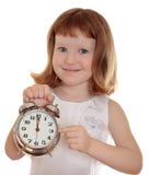 Portrait of little girl holding alarm clock Stock Photography