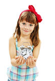 Portrait of little girl holding alarm clock Royalty Free Stock Images