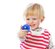 Portrait of a little girl holding a Christmas ball, celebration, Stock Photo