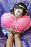 Portrait of little girl holding  heart Stock Photography
