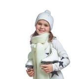 Portrait of a little girl holding ice skates Stock Photos