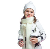 Portrait of a little girl holding ice skates Stock Image