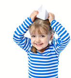 Portrait of a little girl holding a paper boat on a white backgr Royalty Free Stock Images