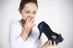 Portrait of little girl holding a shoe. Closeup Royalty Free Stock Photography