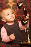 Portrait of little girl holds up retro phone royalty free stock photos
