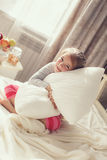 Portrait of a little girl hugging a pillow Royalty Free Stock Photos