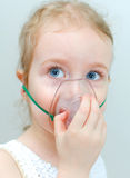 Portrait of little girl with inhalator Royalty Free Stock Images