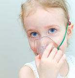 Portrait of little girl with inhalator Stock Image