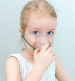 Portrait of little girl with inhalator Stock Photos