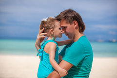 Portrait of a little girl kissing a dad in the Stock Photography