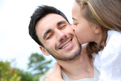 Portrait of little girl kissing her father Stock Photo